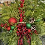 Planter A 8″ Plaid Bow with accents, berries and cones.